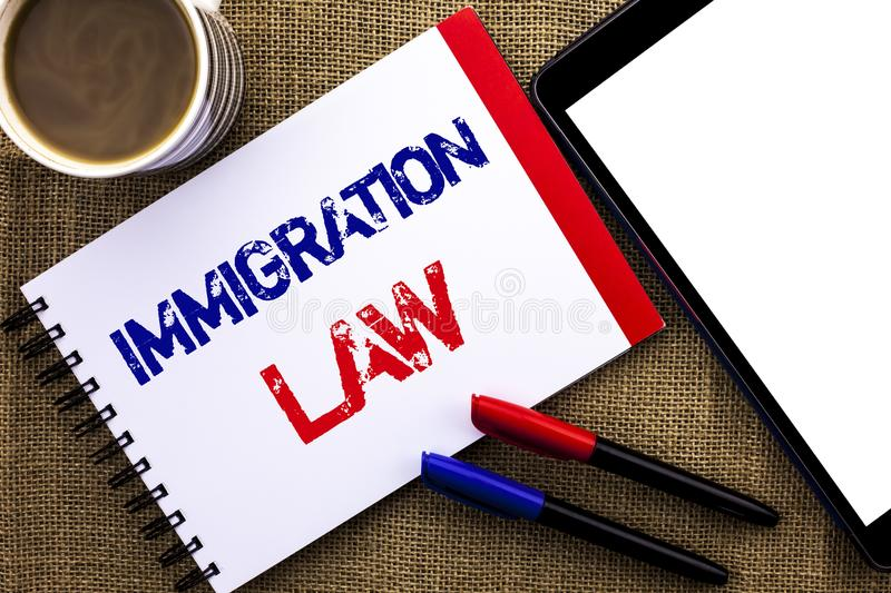 Handwriting text Immigration Law. Concept meaning National Regulations for immigrants Deportation rules written on Notebook Book o. Handwriting text Immigration stock image