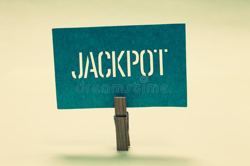 Handwriting text Jackpot. Concept meaning Large cash prize in game Lottery Big award Gambling related Clothespin holding. Turquoise paper important communicate stock photos