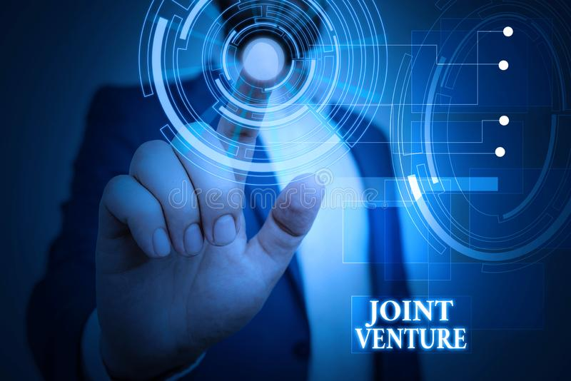 Handwriting text Joint Venture. Concept meaning Collaboration Arrangement Parties Partnership Team Male human wear. Handwriting text Joint Venture. Conceptual royalty free stock images