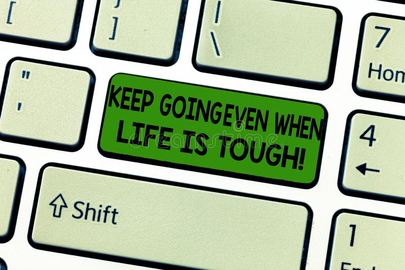 Handwriting text Keep Going Even When Life Is Tough. Concept meaning Overcome difficulties reach your goals Keyboard key. Intention to create computer message stock photos