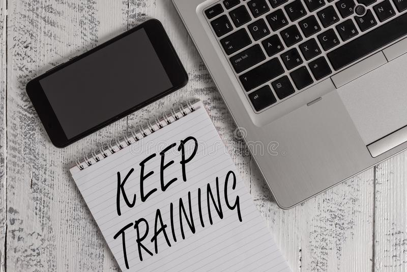 Handwriting text Keep Training. Concept meaning Grounding Drilling Always Wonder Be Curious Learn Metallic laptop blank. Handwriting text Keep Training stock photos
