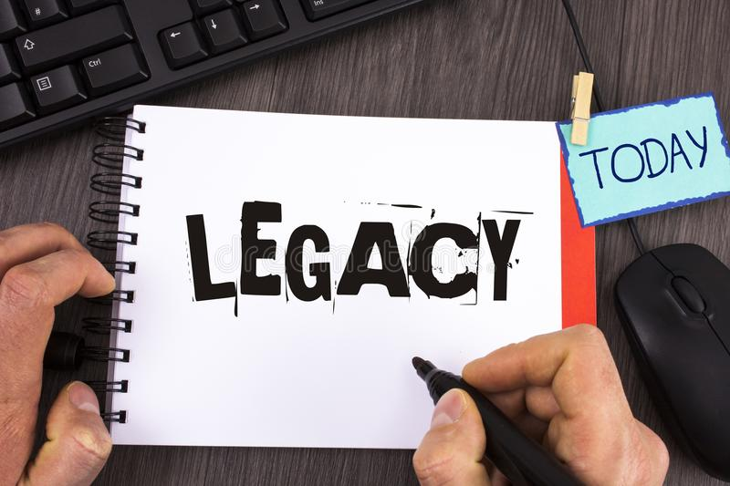 Handwriting text Legacy. Concept meaning Transmitted Received from an ancestor Money Properties given by will written by Man on No. Handwriting text Legacy stock photos