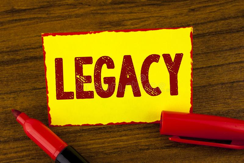 Handwriting text Legacy. Concept meaning Transmitted Received from an ancestor Money Properties given by will written on Yellow St. Handwriting text Legacy royalty free stock photo