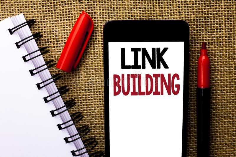 Handwriting text Link Building. Concept meaning Process of acquiring hyperlinks from other websites Connection written on Mobile P. Handwriting text Link stock photography