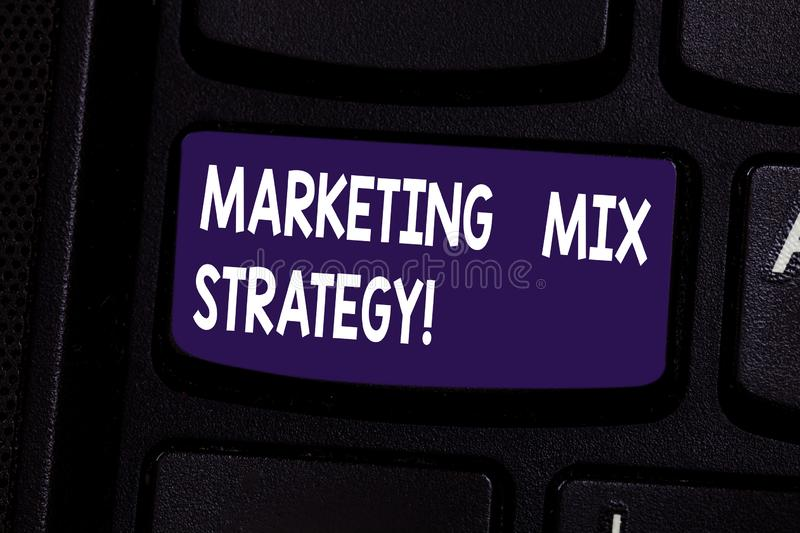 Handwriting text Marketing Mix Strategy. Concept meaning Set of governable tactical marketing tool company use Keyboard. Key Intention to create computer stock photo