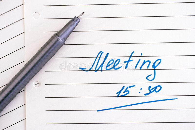 Handwriting text Meeting 15 30  on lined paper with pen royalty free stock photography