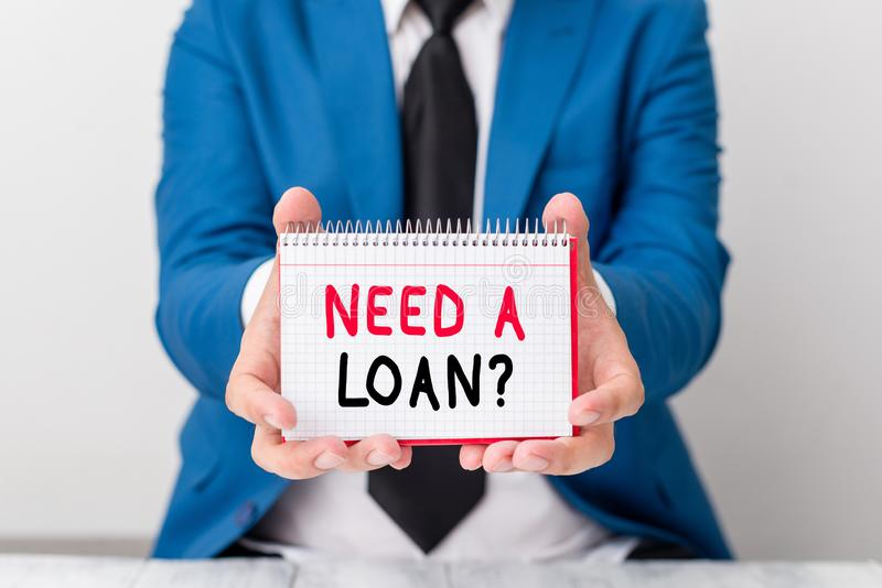 Handwriting text Need A Loan Question. Concept meaning asking he need money expected paid back with interest Man holds. Handwriting text Need A Loan Question royalty free stock photos