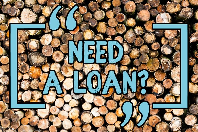 Handwriting text Need A Loan Question. Concept meaning asking he need money expected paid back with interest Wooden. Handwriting text Need A Loan Question stock photography