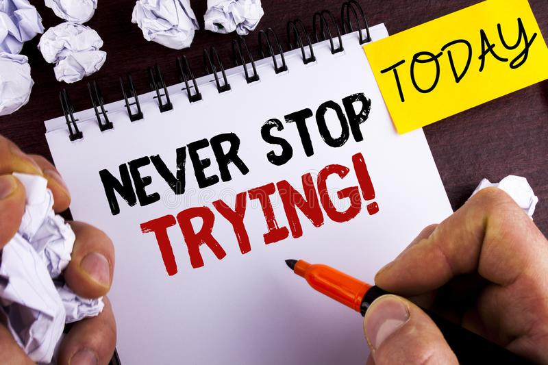 Handwriting text Never Stop Trying Motivational Call. Concept meaning go on do not give up Self confidence written by Man on Notep. Handwriting text Never Stop royalty free stock image