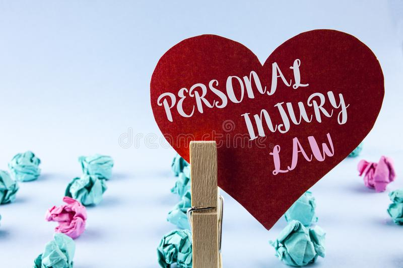 Handwriting text Personal Injury Law. Concept meaning guarantee your rights in case of hazards or risks written on Red Paper Heart. Handwriting text Personal royalty free stock photography