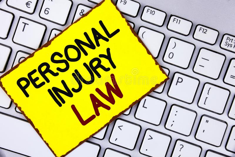 Handwriting text Personal Injury Law. Concept meaning guarantee your rights in case of hazards or risks written on Yellow Sticky N. Handwriting text Personal stock image