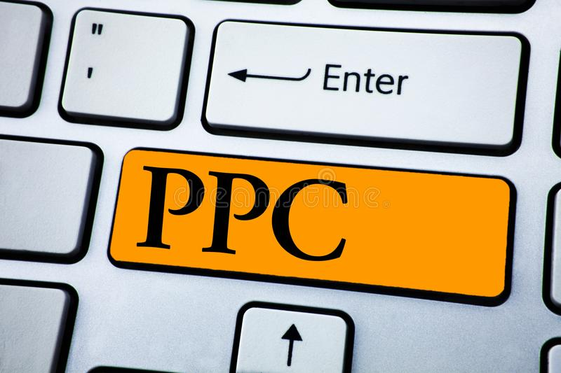 Handwriting text Ppc. Concept meaning Pay Per Click Advertising Strategies Direct Traffic to Websites written on Orange Key Button. Handwriting text Ppc. Concept royalty free stock photography