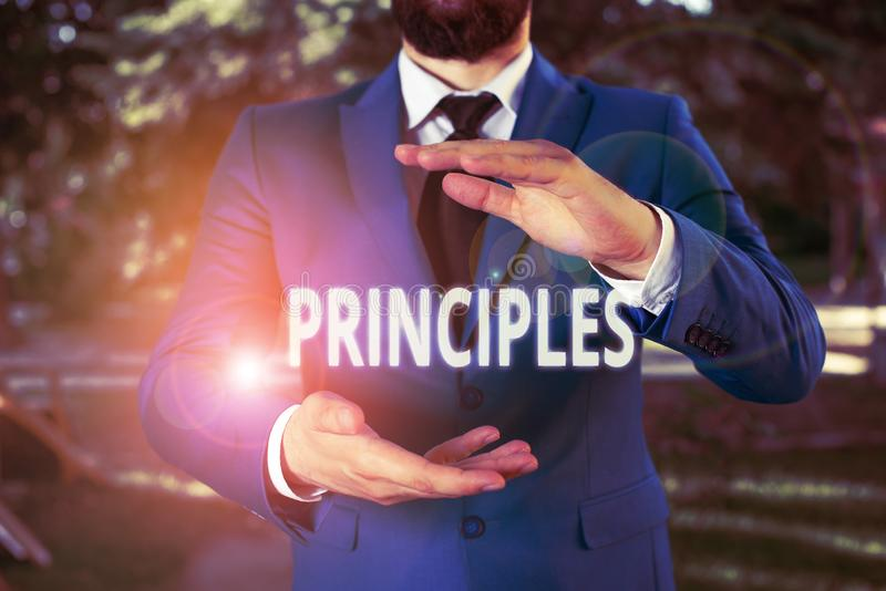 Handwriting text Principles. Concept meaning fundamental truth that serves as the base for a system of belief Man with opened. Handwriting text Principles royalty free stock photos