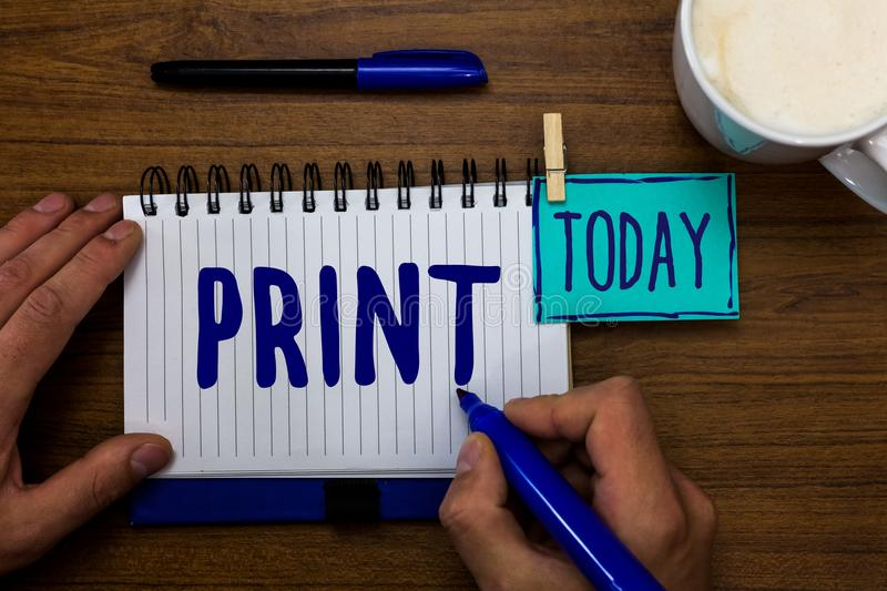 Handwriting text Print. Concept meaning Produce letter numbers symbols on paper by machine using ink or toner Marker pens notepad. Cup milk coffee daily stock photos