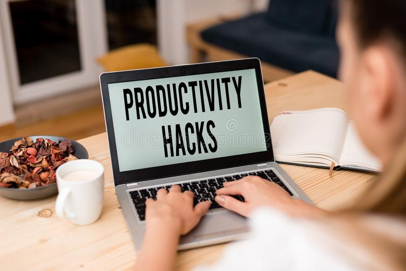 Handwriting text Productivity Hacks. Concept meaning tricks that you get more done in the same amount of time woman. Handwriting text Productivity Hacks stock photography