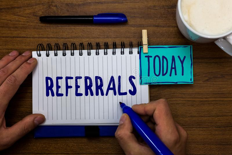 Handwriting text Referrals. Concept meaning Act of referring someone or something for consultation review Marker pens notepad cup. Milk coffee daily memories stock photo