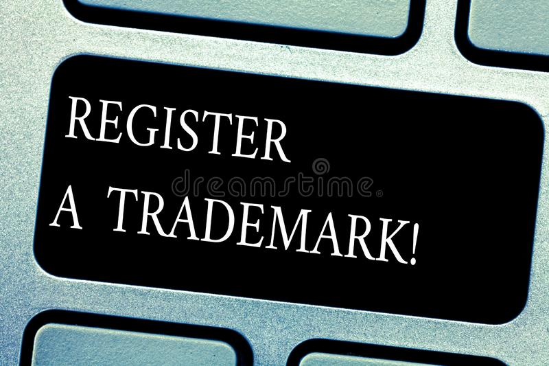 Handwriting text Register A Trademark. Concept meaning To record or list as official company brand or logo Keyboard key. Intention to create computer message royalty free stock photography