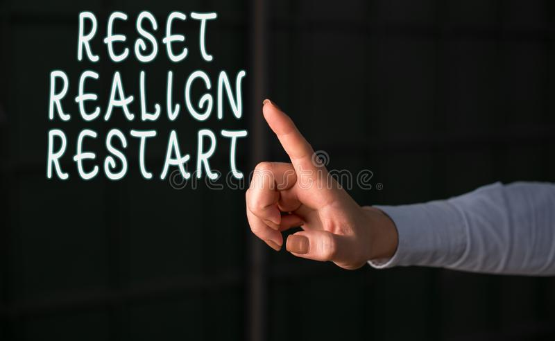 Handwriting text Reset Realign Restart. Concept meaning Life audit will help you put things in perspectives Finger. Handwriting text Reset Realign Restart royalty free stock photography