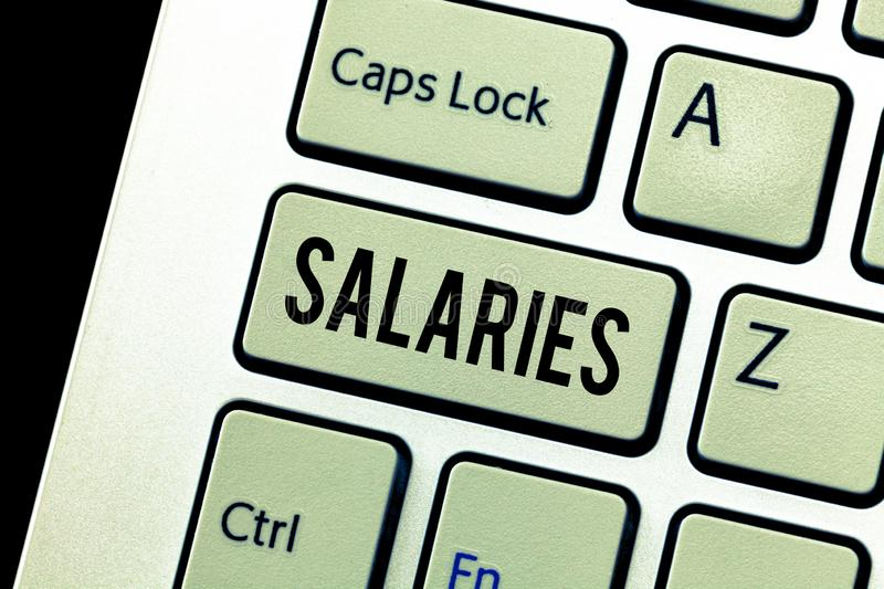 Handwriting text Salaries. Concept meaning fixed regular payment typically paid on monthly basis period time.  stock photography