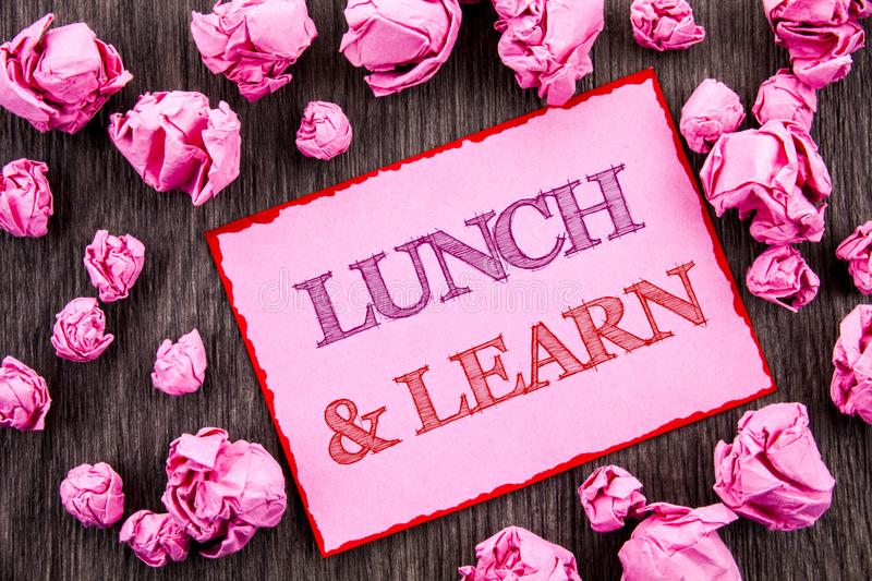 Handwriting text showing Lunch And Learn. Business photo showcasing Presentation Training Board Course written on Pink Sticky Note. Handwriting text showing royalty free stock images