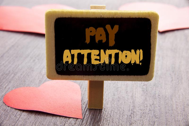 Handwriting text showing Pay Attention. Business photo showcasing Be Careful Beware Mindful Alarm written on blackboard on the woo. Handwriting text showing Pay royalty free stock images