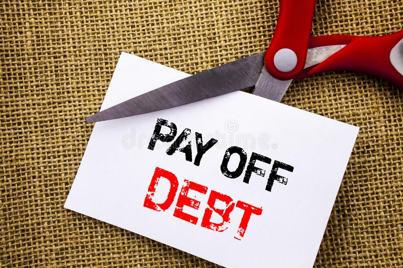 Handwriting text showing Pay Off Debt. Conceptual photo Reminder To Paying Owed Financial Credit Loan Bills written on Sticky Note. Handwriting text showing Pay royalty free stock photography