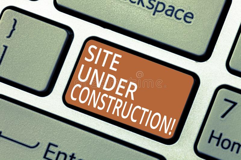 Handwriting text Site Under Construction. Concept meaning Implies something is being built for the first time Keyboard stock photography