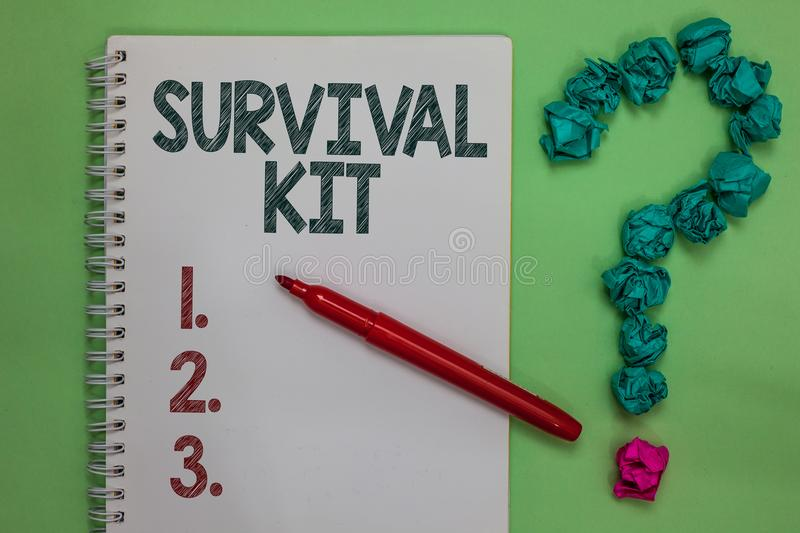 Handwriting text Survival Kit. Concept meaning Emergency Equipment Collection of items to help someone Notebook marker crumpled pa. Pers forming question mark royalty free stock photo