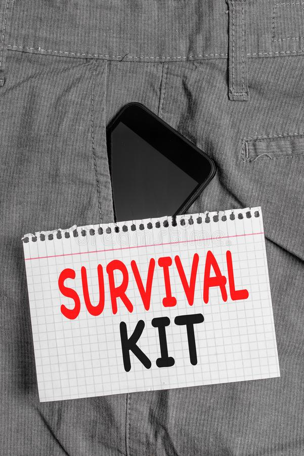Handwriting text Survival Kit. Concept meaning Emergency Equipment Collection of items to help someone Smartphone device. Handwriting text Survival Kit royalty free stock image