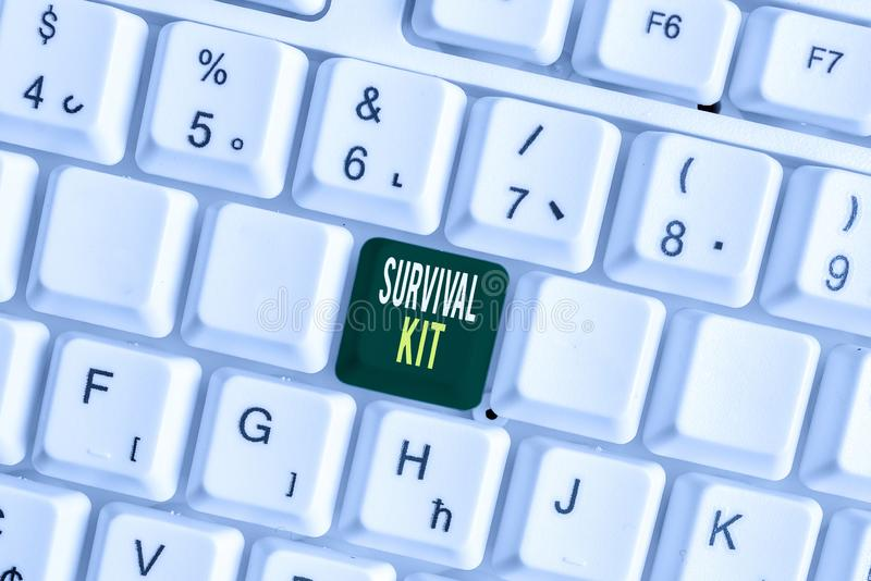 Handwriting text Survival Kit. Concept meaning Emergency Equipment Collection of items to help someone White pc keyboard. Handwriting text Survival Kit stock image