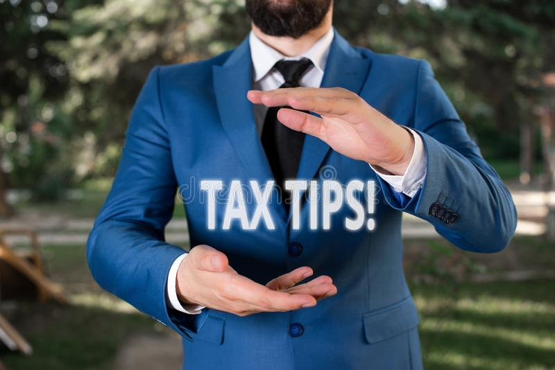 Handwriting text Tax Tips. Concept meaning compulsory contribution to state revenue levied by government Man with opened. Handwriting text Tax Tips. Conceptual stock image
