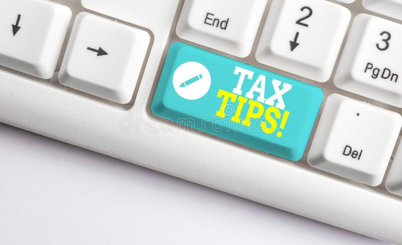 Handwriting text Tax Tips. Concept meaning compulsory contribution to state revenue levied by government White pc. Handwriting text Tax Tips. Conceptual photo royalty free stock photos