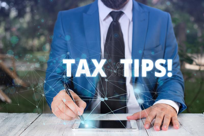 Handwriting text Tax Tips. Concept meaning compulsory contribution to state revenue levied by government Male human wear. Handwriting text Tax Tips. Conceptual stock photos