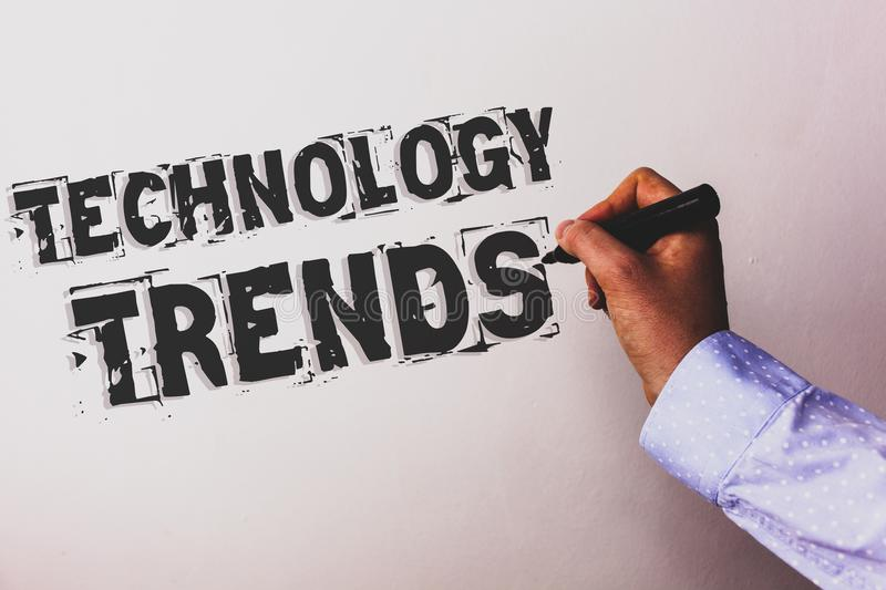 Handwriting text Technology Trends. Concept meaning Trending Modern Viral Advanced Development Trendy New Advisors hand holding bl. Ack marker whiteboard written royalty free stock photography