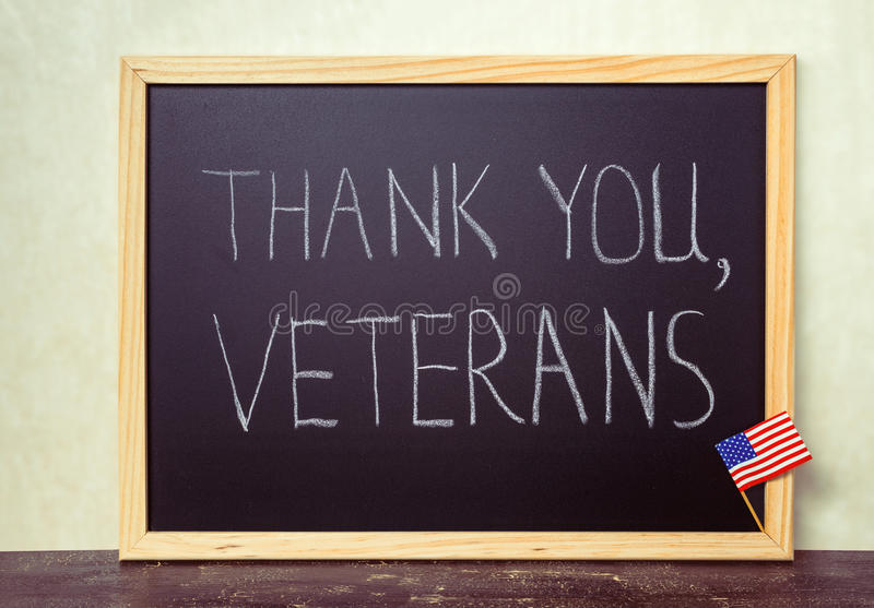 Handwriting text thank you veterans is written in chalkboard wit stock photo