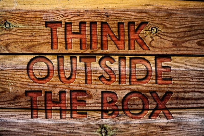 Handwriting text Think Outside The Box. Concept meaning Thinking of new and creative solution leads to success Wooden background v. Intage wood board wild royalty free stock photo