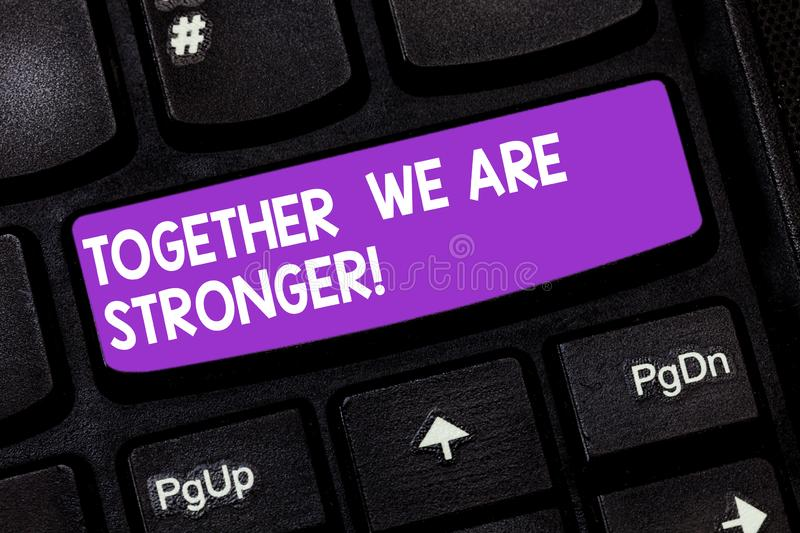 Handwriting text Together We Are Stronger. Concept meaning Working on a team gives best business results Keyboard key. Intention to create computer message stock images