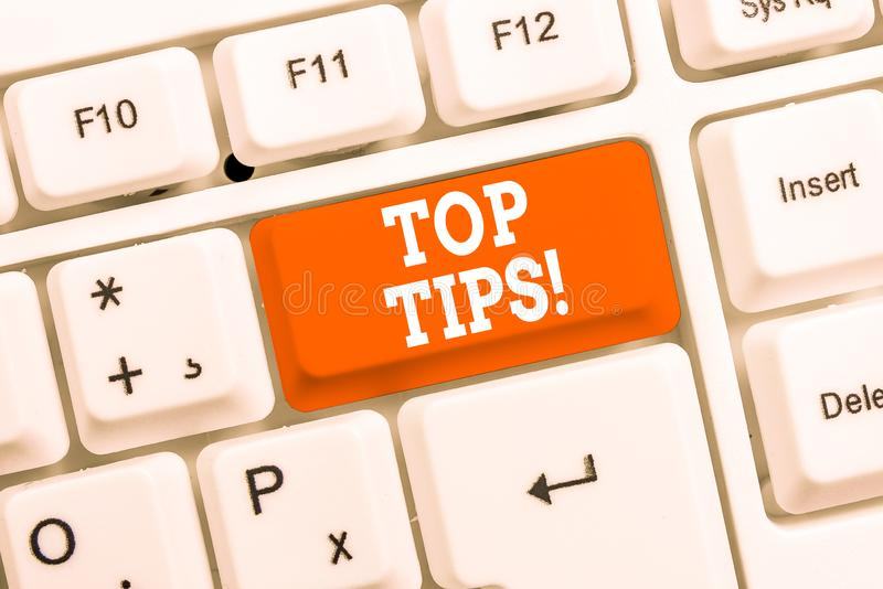 Handwriting text Top Tips. Concept meaning small but particularly useful piece of practical advice White pc keyboard. Handwriting text Top Tips. Conceptual photo stock photo