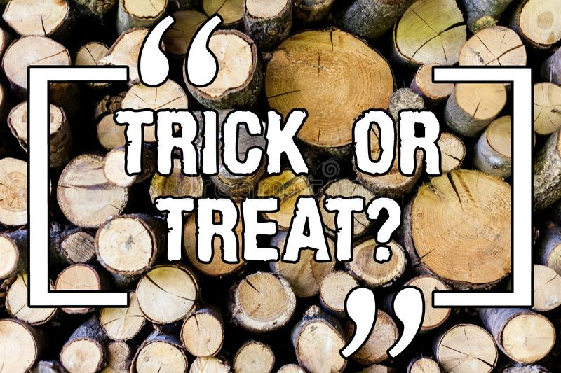 Handwriting text Trick Or Treat. Concept meaning Halloween tradition consisting in asking for sweets Wooden background. Vintage wood wild message ideas stock photography