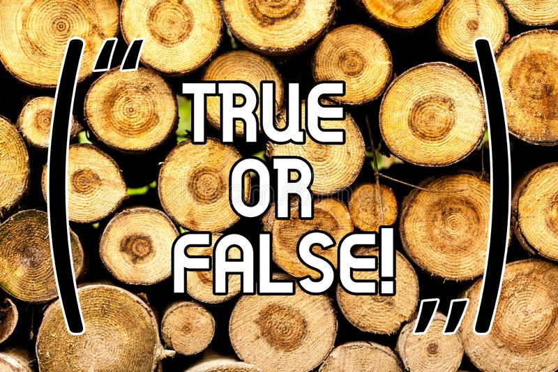 Handwriting text True Or False. Concept meaning Decide between a fact or telling a lie Doubt confusion Wooden background. Vintage wood wild message ideas royalty free stock photos