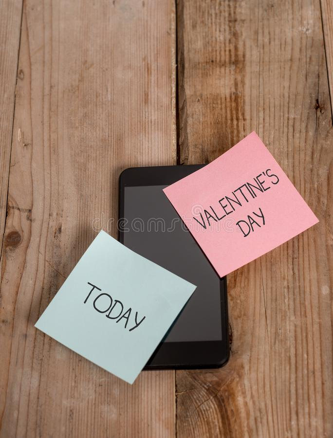 Handwriting text Valentine S Day. Concept meaning time when showing show feelings of love and affection Smartphone two. Handwriting text Valentine S Day royalty free stock photography