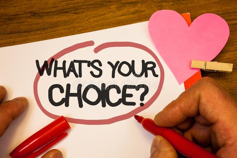 Handwriting text What S Your Choice Question. Concept meaning Option Decision Preferred Opinion Preference Human hand retain red p. En circled black words paper stock photo