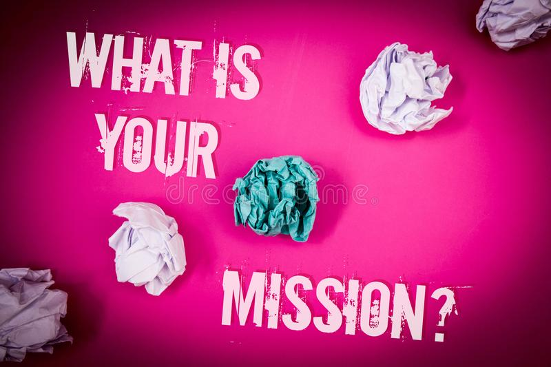 Handwriting text What Is You Mission Question. Concept meaning asking someone about his plans and to-do list Light pink floor circ. Led shadow ruffled white royalty free stock photography