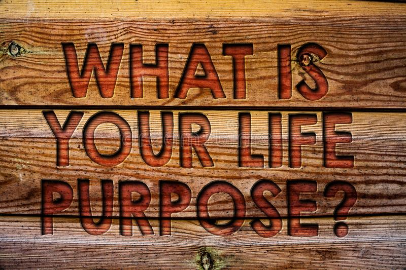 Handwriting text What Is Your Life Purpose Question. Concept meaning Personal Determination Aims Achieve Goal Wooden background vi. Ntage wood board wild message royalty free stock photography