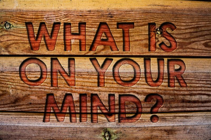Handwriting text What Is On Your Mind Question. Concept meaning Open minded thinks of intellectual innovation Wooden background vi. Ntage wood board wild message stock images