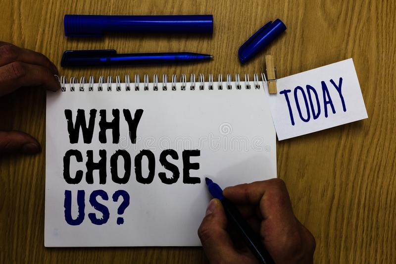 Handwriting text Why Choose Us question. Concept meaning Reasons for choosing our brand over others arguments Man holding marker n royalty free stock image