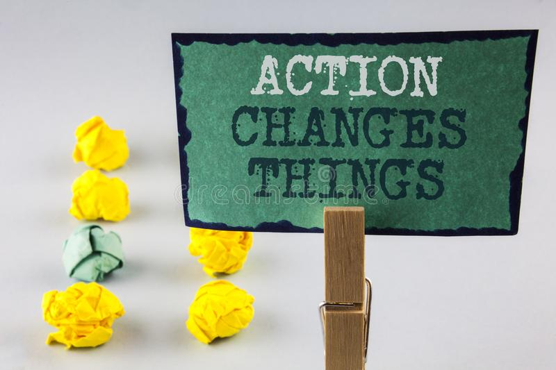 Handwriting text writing Action Changes Things. Concept meaning doing something is like chain Improve Reflects written on Sticky N. Handwriting text writing stock photo