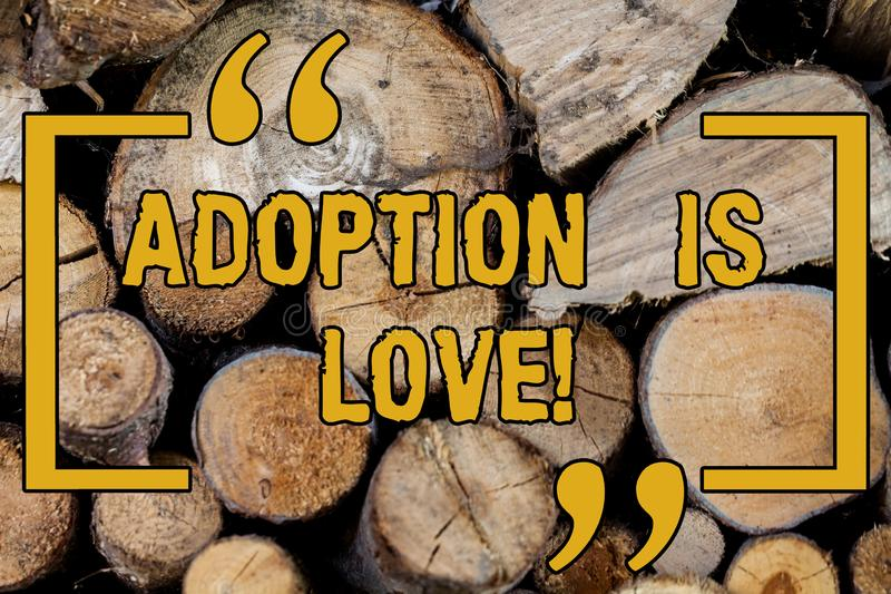 Handwriting text writing Adoption Is Love. Concept meaning action or fact of adopting or being adopted is kind Wooden royalty free stock photos