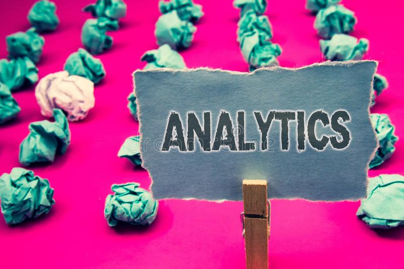 Handwriting text writing Analytics. Concept meaning Data Analysis Financial Information Statistics Report Dashboard Clothespin hol stock image