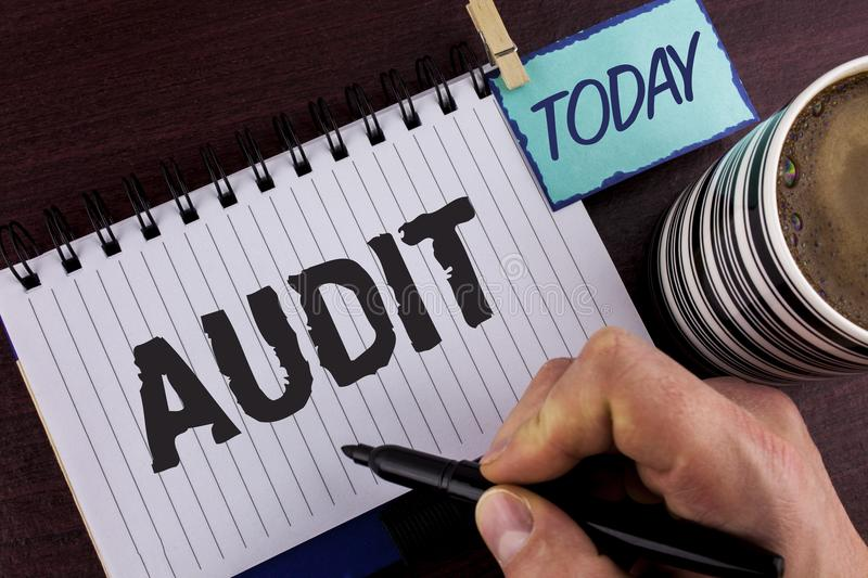 Handwriting text writing Audit. Concept meaning Local company auditors perform their financial investigation annually written by M. An Notepad holding Marker in stock photography